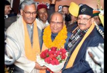 CM Trivendra congratulated Banshidhar Bhagat on being appointed BJP state president